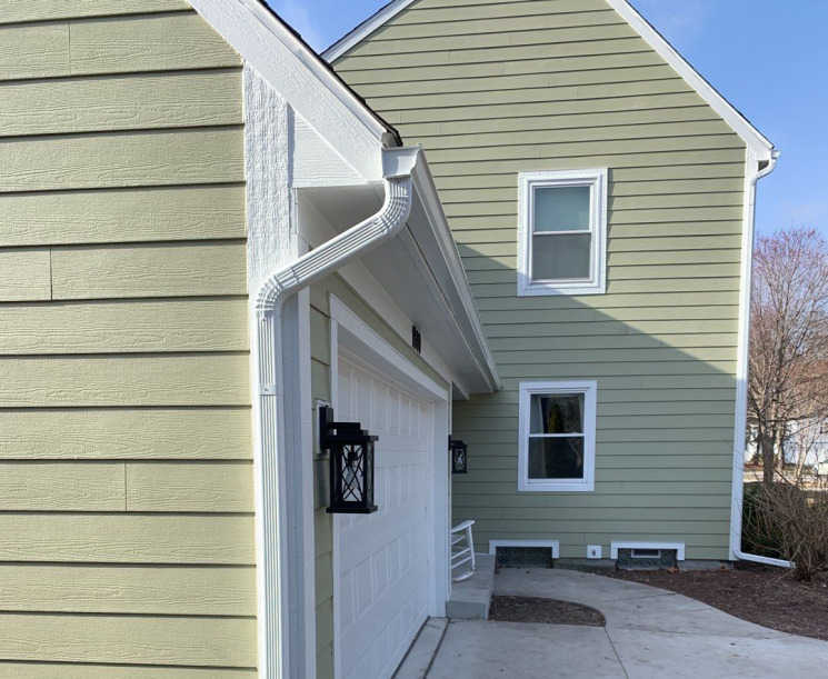 Outdated Siding Replaced on this Two-story Colonial-style Home