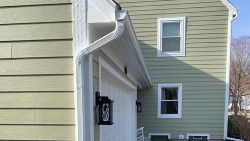 Outdated Siding Gets Replaced on this Two-story Colonial-style Home